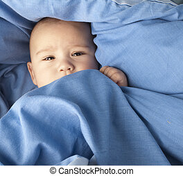 blue blanket - afraid baby under a blue blanket closeup