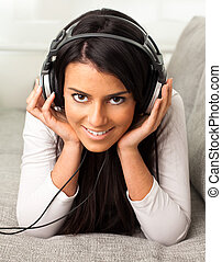 girl listen to music on the sofa
