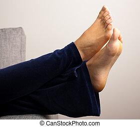 girl foots - girl resting on sofa, extreme closeup of foots