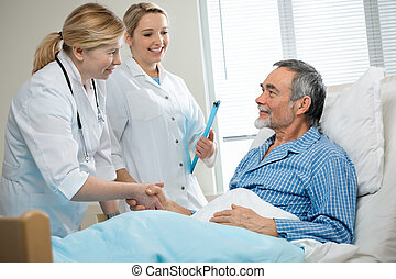 in hospital - doctor shakes hands with patient in hospital...