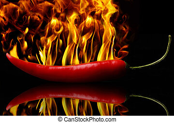 peperoni on fire - A hot red peperoni in flames