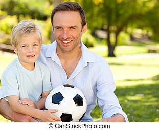 Father with his son after a footbal