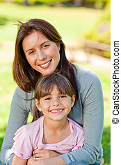 Happy mother with her daughter in t