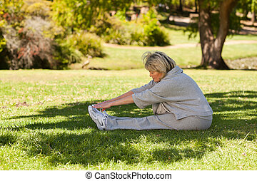 Mature woman doing her streches in