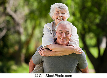 Man giving wife a piggyback