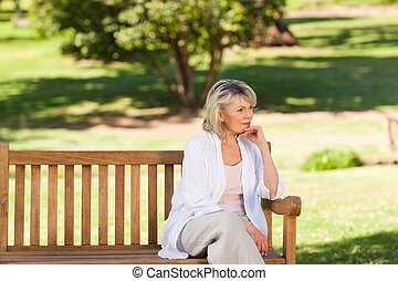 Senior woman thinking on the bench