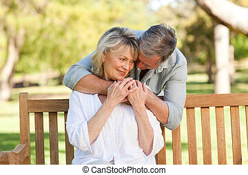 Elderly man hugging his wife who is