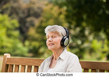 Elderly woman listening to some music