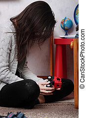Lost of child - Young sad woman sitting in children room...