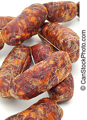 spanish chorizos - some red spanish chorizos on a white...