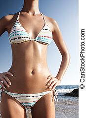 beautiful body in white bikini - close up shot of young...
