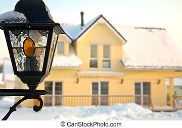 wall-mounted lantern in winter