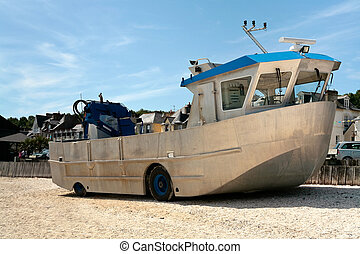 amphibious boat on beach in summer