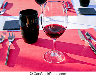 glass with red wine - glass with wine on red tablenapkin