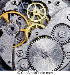Clockwork close-up - Part of clockwork with gears, spring,...