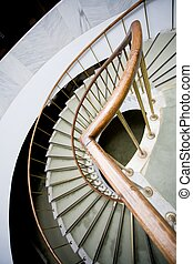 Bend of stairs - Bended brown wooden handhold of spiral...