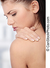 Back pain - Woman from behind, naked body, holding her neck...