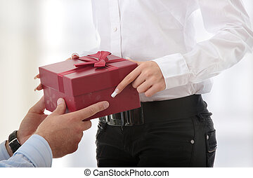 Gift box - Business man offering a gift to a woman
