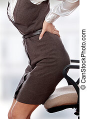 Back pain - Business woman with back pain after long work on...
