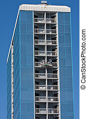 Window Washers Working - Window washers working on a high...