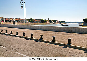 road on levee of river - levee with road of river Rhone in...