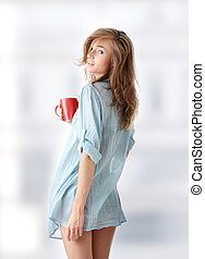Morning coffee - The beautiful young woman drinks morning...