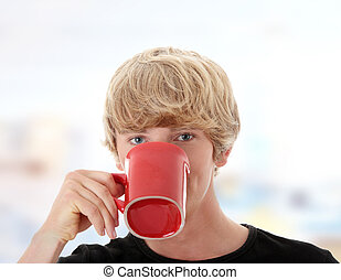 Man drinking a coffee or tea