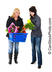 Two shopping woman in the supermarket with basket
