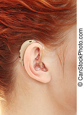 Hearing aid - Redhead woman wearing hearing aid