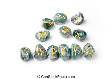 Elder Futhark Runes - Golden runes carved on blue-green...