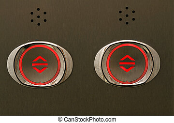 elevator buttons - illuminating the image of a black...
