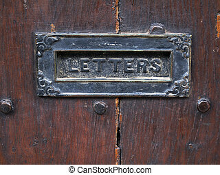 Ancient letterbox - Ancient letterbox in a wooden door...