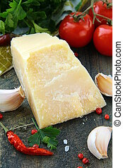 Parmesan cheese garlic, chili pepper and parsley on the old...