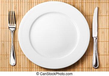 Serving fork, knife, plate - Restaurant serving metal fork,...
