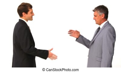 Two businessmen shaking hands against a white background