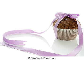 Muffin with a bow - One muffin, tied with a purple bow on a...