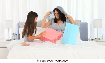 Mother and her daughter on the bed