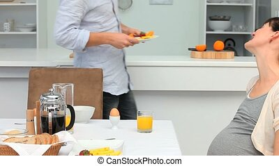 Future parents having a breakfast in the kitchen
