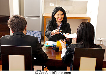 You're hired, sign here! - Manager woman giving an agreement...