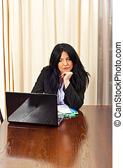Bored business woman browse on laptop in her office