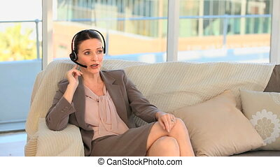 Brunette speaking over the headset at home