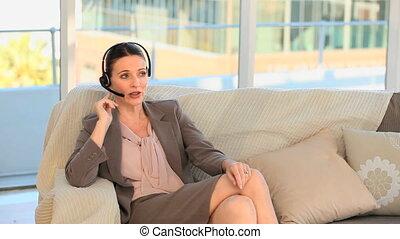 Brunette speaking over the headset