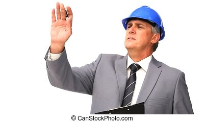 Businessman working on a building project against a white...
