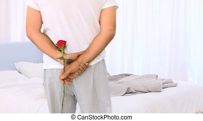 Mature man offering a rose to his wife