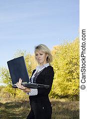 Travel destination - Business travel. Young woman in autumn...