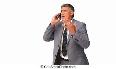 Businessman getting nervous on phone isolated on a white...