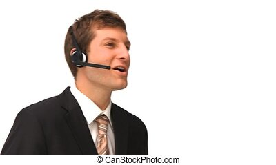 Young businessman with an headset against a white background