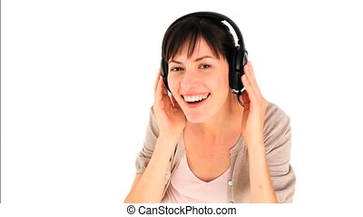 Cute young girl listening to music - Cute young girl...