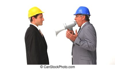 Businessman shouting through a megaphone against a white...