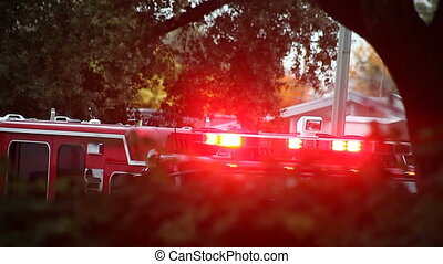 fire truck lights flashing - a fire truck responds to an...